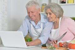 Senior man and woman  in the kitchen Stock Photos