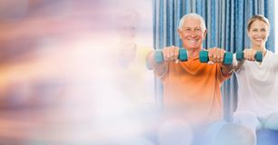 Senior man with woman lifting dumbbells in gym. Digital composite of Senior men with women lifting dumbbells in gym Royalty Free Stock Image