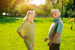 Senior man and woman outdoors. Royalty Free Stock Images