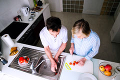Senior man and woman preparing breakfast. Sunny morning. royalty free stock images