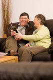 Senior man and woman relaxing with wine Stock Photo