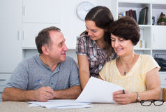 Senior man and woman signing documents Royalty Free Stock Photo