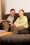 Senior man and woman sitting together Stock Photography