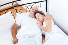 Senior  man and   woman sleeping Royalty Free Stock Photos