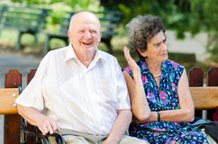 Senior man and woman smoking Stock Photos