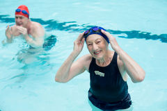 Senior man and woman swimming in pool. High angle view of senior man and woman swimming in pool Stock Photography