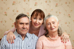 Senior man, woman with their caregiver at home. Stock Image