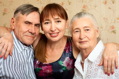 Senior man, woman with their caregiver at home. Royalty Free Stock Photos
