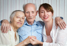 Senior man, woman with their caregiver at home. Royalty Free Stock Photography