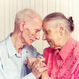 Senior Man, Woman with their at Home. Royalty Free Stock Image