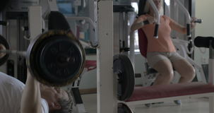 Senior man and woman working out in the gym stock footage