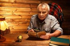 Senior man in wooden interior Stock Image