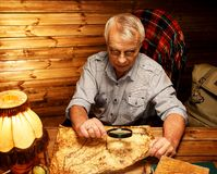 Senior man in wooden interior Stock Images
