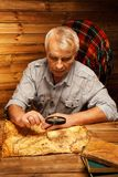 Senior man in wooden interior Royalty Free Stock Photography