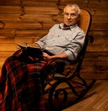 Senior man in wooden interior Royalty Free Stock Photo