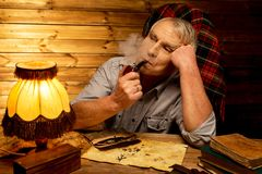Senior man in wooden interior Stock Images