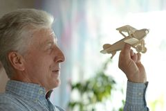 Senior man with wooden plane Royalty Free Stock Photography