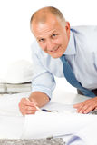Senior man work on blueprints construction plans Royalty Free Stock Images