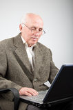 Senior man working on computer Royalty Free Stock Image