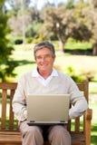 Senior man working on his laptop Stock Photos