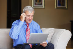 Senior man working at home Stock Photography