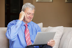 Senior man working at home Stock Image
