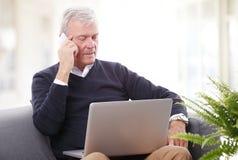 Senior man working at home Royalty Free Stock Images