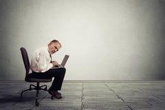 Senior man working on laptop computer Royalty Free Stock Image