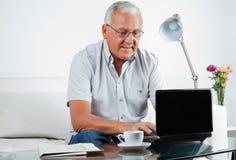 Senior Man Working on Laptop Royalty Free Stock Images