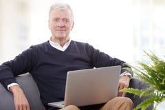 Senior man working online Stock Images
