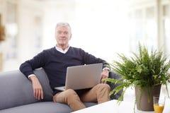 Senior man working online Royalty Free Stock Image