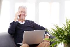 Senior man working online Royalty Free Stock Photo