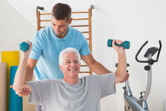 Senior man working out with his trainer Stock Photography