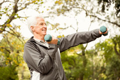 Senior man working out in park Stock Photos
