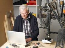 Senior man working Stock Images