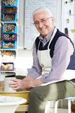 Senior Man Working At Pottery Wheel In Studio Royalty Free Stock Images