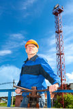 Senior man in working uniform with valve gate Royalty Free Stock Photos