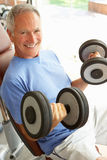 Senior Man Working With Weights stock photography