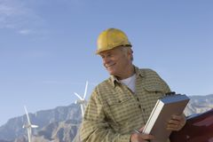 Senior Man Working At Wind Farm Royalty Free Stock Photo