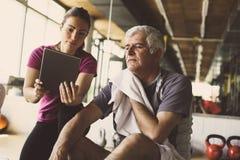 Senior man workout in rehabilitation center. Royalty Free Stock Photos