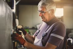 Senior man in workshop. Stock Photography