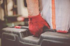 Senior man in workshop. Man holding carries tool bag. Royalty Free Stock Image
