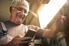 Senior man in workshop. Royalty Free Stock Images