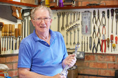 Senior Man in Workshop Standing With Tools Stock Image