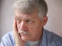 Senior man worries Stock Photography