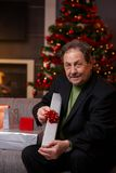 Senior man wrapping presents at christmas Stock Photography