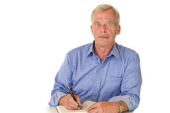 Senior man writes his memories Royalty Free Stock Photo
