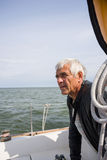 Senior man on yacht looking for the land Royalty Free Stock Photo