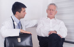 Senior man with young doctor Stock Photo