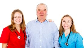 Senior man and young female doctors. Photo of senior men and young female doctors Royalty Free Stock Images